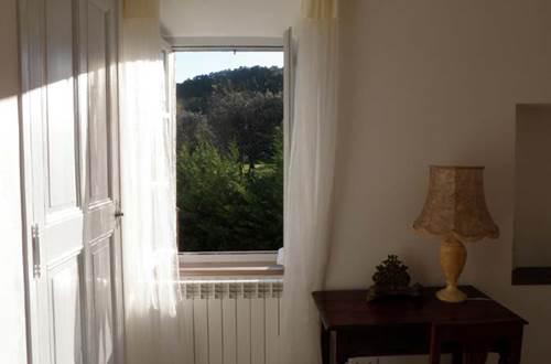appart_1er_etage_chambre_a_coucher_vue_sur_la_montagne_cadabuech_4_ ©
